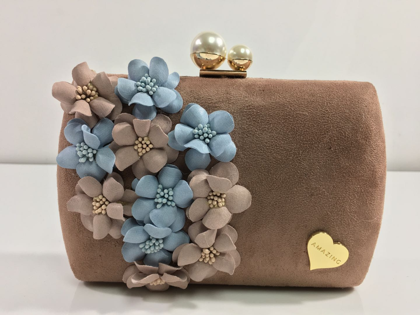We proudly manufacture a wide range of Clutches and Evening bags